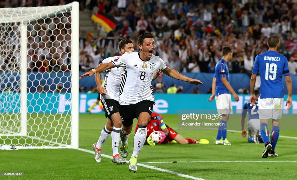 Mesut Oezil of Germany celebrates scoring the opening goal during the UEFA EURO 2016 quarter final match between Germany and Italy at Stade Matmut Atlantique on July 2, 2016 in Bordeaux, France.