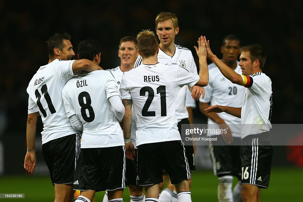 Mesut Oezil (2nd L) of Germany celebrates the forth goal with Miroslav Klose (L), Marco Reus (3rd L), Per Mertesacker (4th L) and Philipp Lahm (R) during the FIFA 2014 World Cup qualifier group C match between German and Sweden at Olympiastadion on October 16, 2012 in Berlin, Germany.