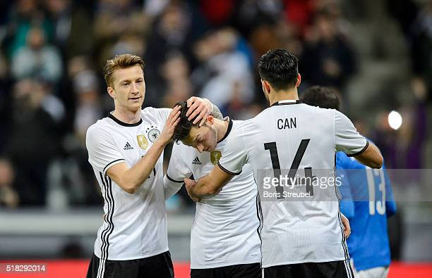 Mesut Oezil of Germany celebrates with team mates after scoring his team's fourth goal by penalty during the International Friendly match between...