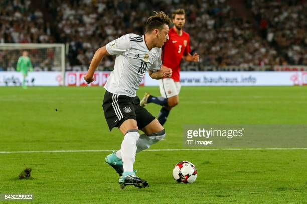 Mesut Oezil of Germany controls the ball during the FIFA 2018 World Cup Qualifier between Germany and Norway at MercedesBenz Arena on September 4...