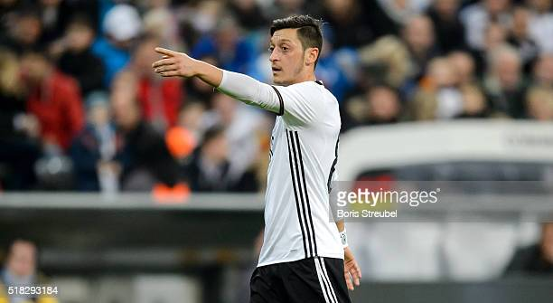 Mesut Oezil of Germany gestures during the International Friendly match between Germany and Italy at Allianz Arena on March 29 2016 in Munich Germany