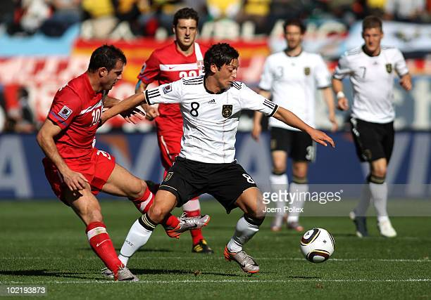 Mesut Oezil of Germany holds off Dejan Stankovic of Serbia during the 2010 FIFA World Cup South Africa Group D match between Germany and Serbia at...