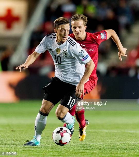 Mesut Oezil of Germany is challenged by Jan Kopic of Czech Republic during the FIFA 2018 World Cup Qualifier between Czech Republic and Germany at...