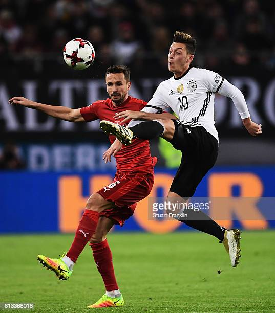 Mesut Oezil of Germany is challenged by Tomas Sivok of Czech during the 2018 FIFA World Cup Qualifier match between Germany and Czech Republic at...