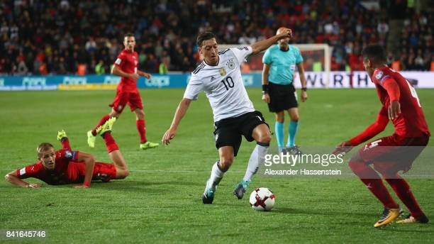 Mesut Oezil of Germany is challenged by Tomas Soucek and Theodor Gebre Selassie of Czech Republik during the FIFA World Cup Russia 2018 Group C...