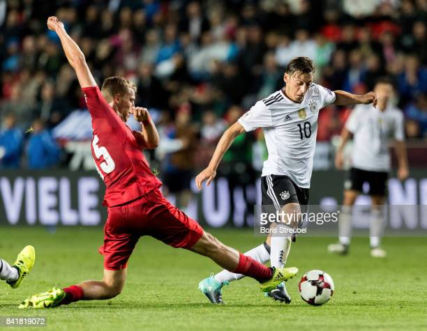 Mesut Oezil of Germany is challenged by Tomas Soucek of Czech Republic during the FIFA 2018 World Cup Qualifier between Czech Republic and Germany at...