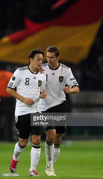 Mesut Oezil of Germany is seen with team mate Miroslav Klose after scoring his teams second goal during the EURO 2012 Group A qualifier match between...