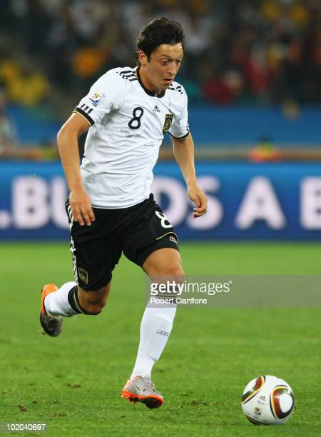 Mesut Oezil of Germany runs with the ball during the 2010 FIFA World Cup South Africa Group D match between Germany and Australia at Durban Stadium...