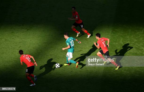 Mesut Oezil of Germany runs with the ball during the 2018 FIFA World Cup Russia group F match between Korea Republic and Germany at Kazan Arena on...
