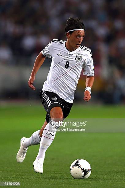 Mesut Oezil of Germany runs with the ball during the FIFA 2014 World Cup Qualifier group C match between Germany and Faeroe Islands at AWD Arena on...