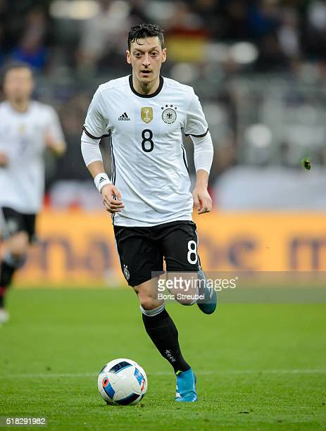 Mesut Oezil of Germany runs with the ball during the International Friendly match between Germany and Italy at Allianz Arena on March 29 2016 in...