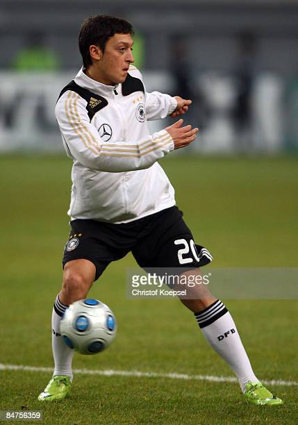 Mesut Oezil of Germany runs with the ball during the International Friendly match between Germany and Norway at the LTU Arena Duesseldorf on February...