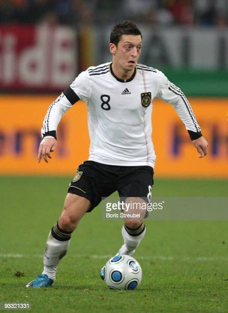 Mesut Oezil of Germany runs with the ball during the International Friendly match between Germany and Ivory Coast at the Schalke Arena on November 18...