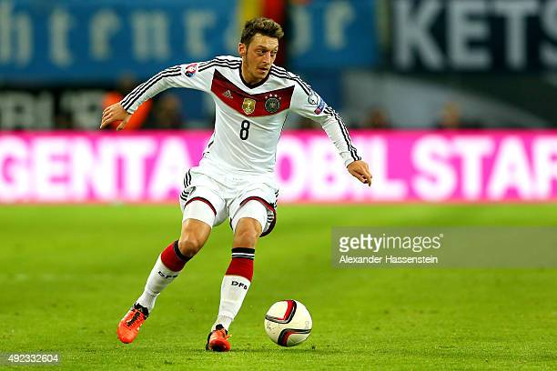 Mesut Oezil of Germany runs with the ball during the UEFA EURO 2016 Group D qualifying match between Germany and Georgia at Stadium Leipzig on...