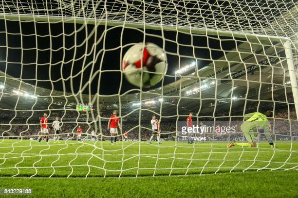 Mesut Oezil of Germany scores a goal during the FIFA 2018 World Cup Qualifier between Germany and Norway at MercedesBenz Arena on September 4 2017 in...