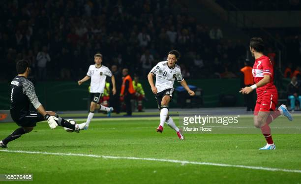 Mesut Oezil of Germany scores his team's 2nd goal during the EURO 2012 Group A qualifier match between Germany and Turkey at Olympia Stadium on...
