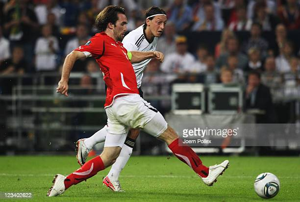 Mesut Oezil of Germany scores his team's fourth goal during the UEFA EURO 2012 qualifying match between Germany and Austria at VeltinsArena on...