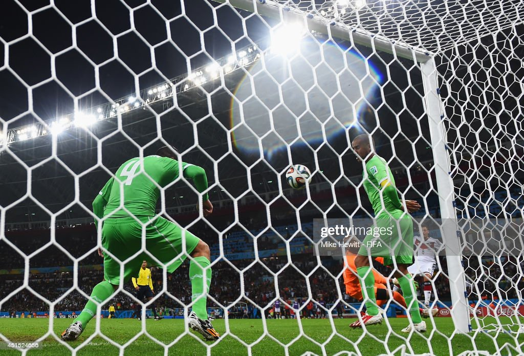 Mesut Oezil (1st R) of Germany scores his team's second goal during the 2014 FIFA World Cup Brazil Round of 16 match between Germany and Algeria at Estadio Beira-Rio on June 30, 2014 in Porto Alegre, Brazil.