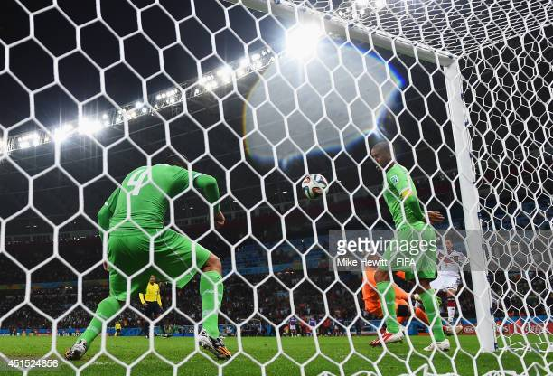 Mesut Oezil of Germany scores his team's second goal during the 2014 FIFA World Cup Brazil Round of 16 match between Germany and Algeria at Estadio...