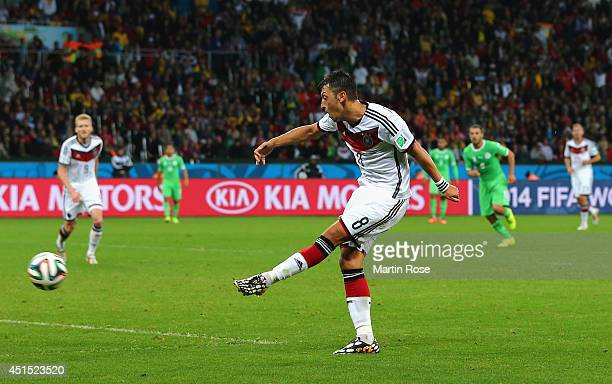 Mesut Oezil of Germany scores his team's second goal in extra time during the 2014 FIFA World Cup Brazil Round of 16 match between Germany and...