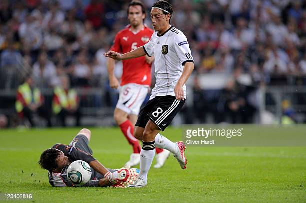 Mesut Oezil of Germany scores the second goal during the UEFA EURO 2012 qualifying match between Germany and Austria at VeltinsArena on September 2...