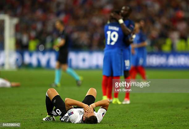 Mesut Oezil of Germany shows his dejection after his team's defeat in the UEFA EURO semi final match between Germany and France at Stade Velodrome on...