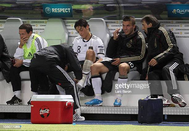 Mesut Oezil of Germany sits on the bench and gets a tape during the EURO 2012 Group A qualifier match between Germany and Turkey at Olympic Stadium...
