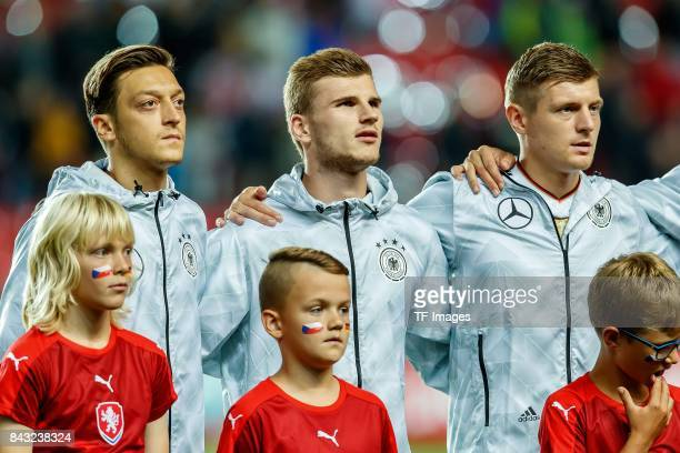 Mesut Oezil of Germany Timo Werner of Germany and Toni Kroos of Germany looks on during the FIFA 2018 World Cup Qualifier between Czech Republic and...