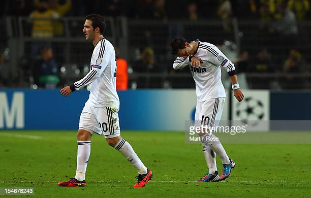 Mesut Oezil of Madird and team mate Gonzalo Higuain look dejected after the UEFA Champions League group D match between Borussia Dortmund and Real...