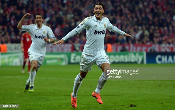 Mesut Oezil of Madrid celebrates after scoring his teams first goal during the UEFA Champoins League Semi Final first leg match between FC Bayern...