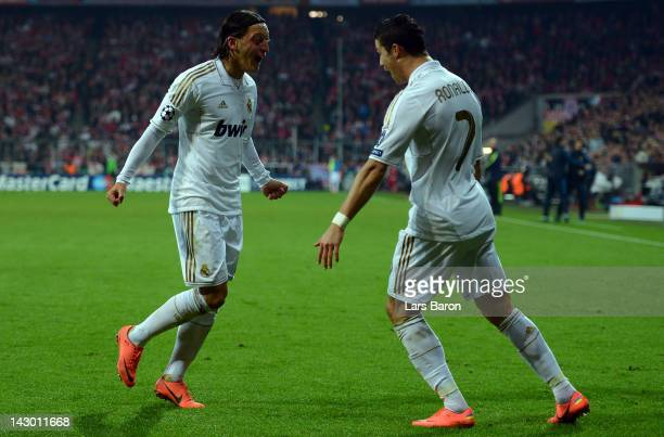 Mesut Oezil of Madrid celebrates with team mate Cristiano Ronaldo after scoring his teams first goal during the UEFA Champoins League Semi Final...