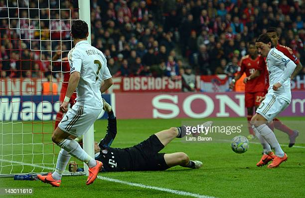 Mesut Oezil of Madrid scores his teams first goal during the UEFA Champoins League Semi Final first leg match between FC Bayern Muenchen and Real...