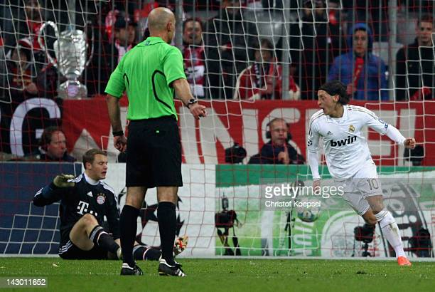 Mesut Oezil of Real Madrid celebrates the first goal against Manuel Neuer of Bayern during the UEFA Champions League Semi Final first leg match...