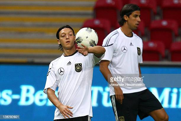 Mesut Oezil of the German national football team and his team mate Sami Khedira during a training session at Tuerk Tuerk Telekom Arena on October 6...