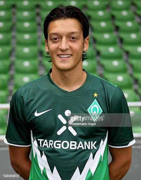 Mesut Oezil poses during the team presentation at the Weser stadium on August 16 2010 in Bremen Germany