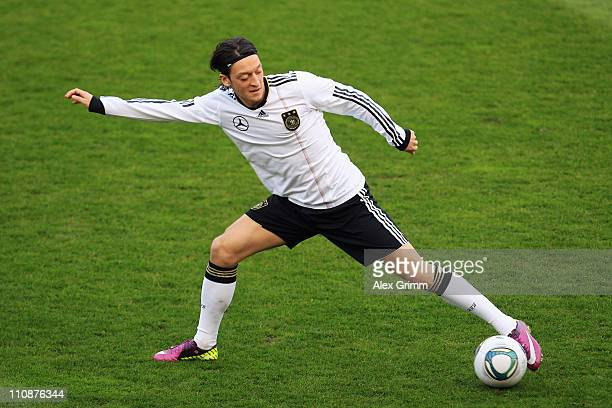 Mesut Oezil shoots the ball during a training session of the German national football team ahead of their Euro 2012 qualifying match against...