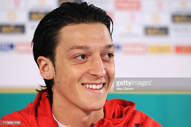 Mesut Oezil smiles during a press conference of the German national football team ahead of their Euro 2012 qualifying match against Kazakhstan on...