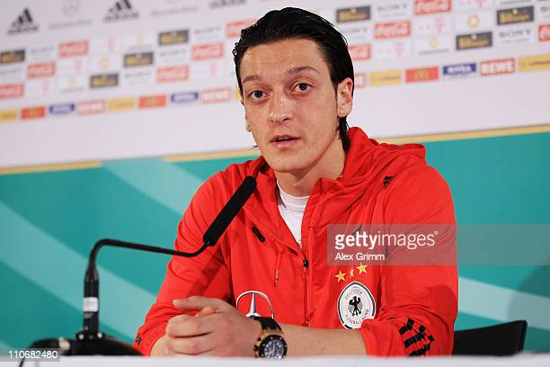 Mesut Oezil talks to the media during a press conference of the German national football team ahead of their Euro 2012 qualifying match against...