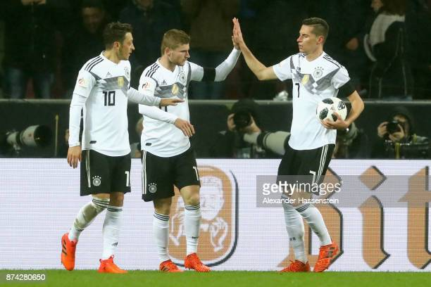 Mesut Oezil Timo Werner and Julian Draxler of Germany celebrate the 2nd team goal during the international friendly match between Germany and France...