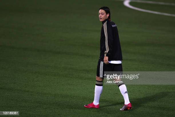 Mesut Oezil walks over the pitch during a training session of the German national football team at the Astana Arena on October 11 2010 in Astana...