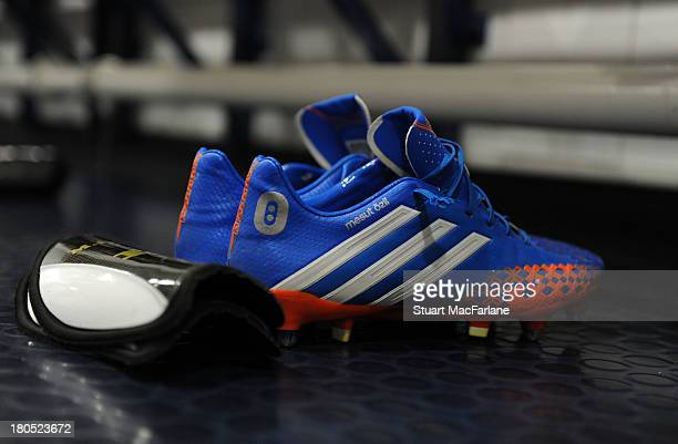 Mesut Oezil's Arsenal boots are laid out in the changing room before the match at Stadium of Light on September 14 2013 in Sunderland England