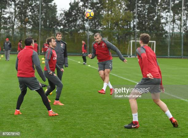 Mesut Ozil Aaron Ramsey Jack Wilshere and Rob Holdng of Arsenal during a training session at London Colney on November 4 2017 in St Albans England