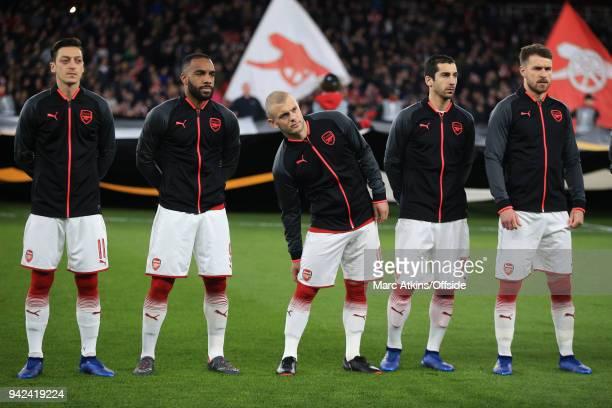 Mesut Ozil Alexandre Lacazette Jack Wilshere Henrikh Mkhitaryan and Aaron Ramsey of Arsenal line up prior to the UEFA Europa League quarter final leg...