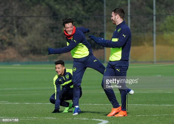 Mesut Ozil Alexis Sanchez and Shkodran Mustafi of Arsenal during the Arsenal Training Session at London Colney on February 14 2017 in St Albans...