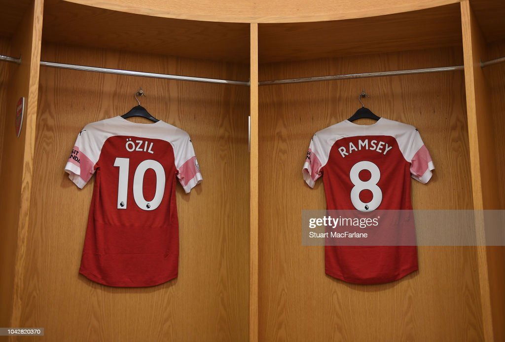 watch 9ea6f a2389 Mesut Ozil and Aaron Ramsey shirts hang in the Arsenal ...