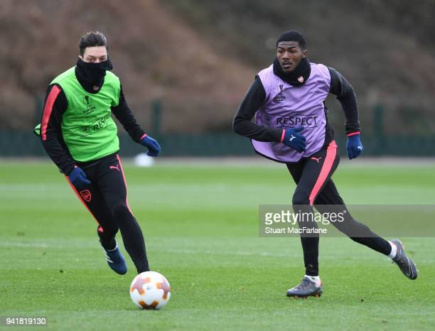 Mesut Ozil and Ainsley MaitlandNiles of Arsenal during a training session at London Colney on April 4 2018 in St Albans England