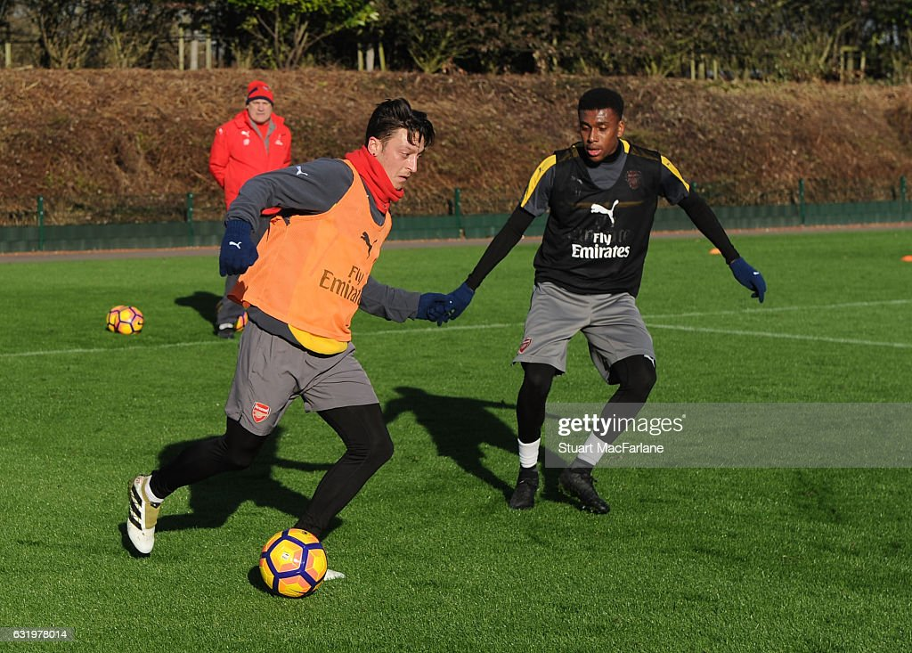 Mesut Ozil and Alex Iwobi of Arsenal during a training session at London Colney on January 18, 2017 in St Albans, England.
