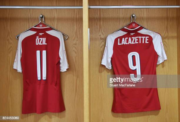 Mesut Ozil and Alex Lacazette shirts in the Arsenal changing room before the Emirates Cup match between Arsenal and Seville at Emirates Stadium on...