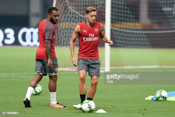 Mesut Ozil and Alexandre Lacazette of Arsenal FC attend a training session ahead of 2017 International Champions Cup football match between Bayern...