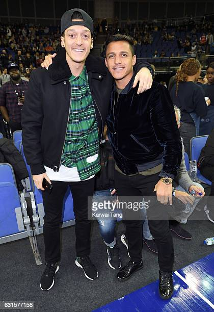Mesut Ozil and Alexis Sanchez attend the Denver Nuggets v Indiana Pacers match as part of the NBA Global Games London 2017 at The O2 Arena on January...